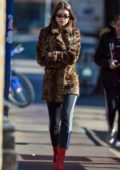 Emily Ratajkowski wears a leopard print jacket and red boots while on a stroll in New York City