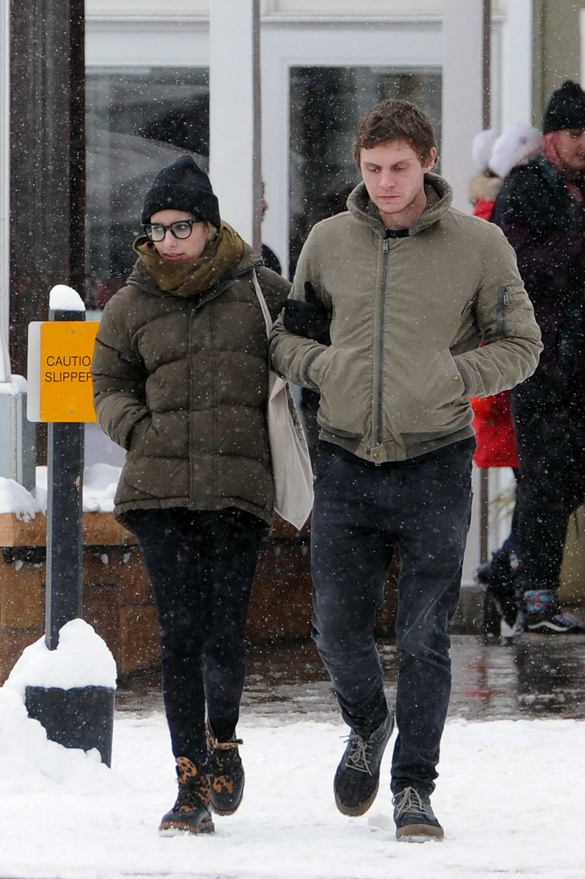Emma Roberts and Evan Peters enjoy a walk in the snow in Park City, Utah