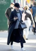 Emma Stone steps out in grey trench coat and a baseball cap in New York City
