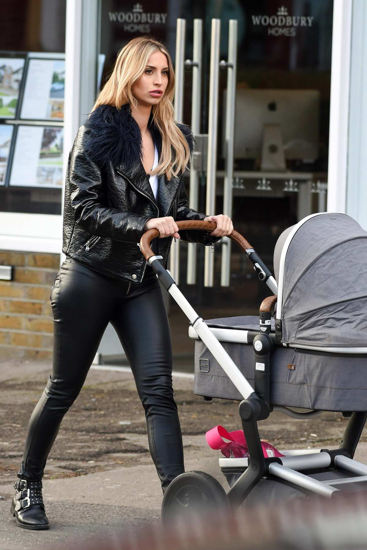 Ferne McCann carts her baby in a stroller while out in Essex, UK