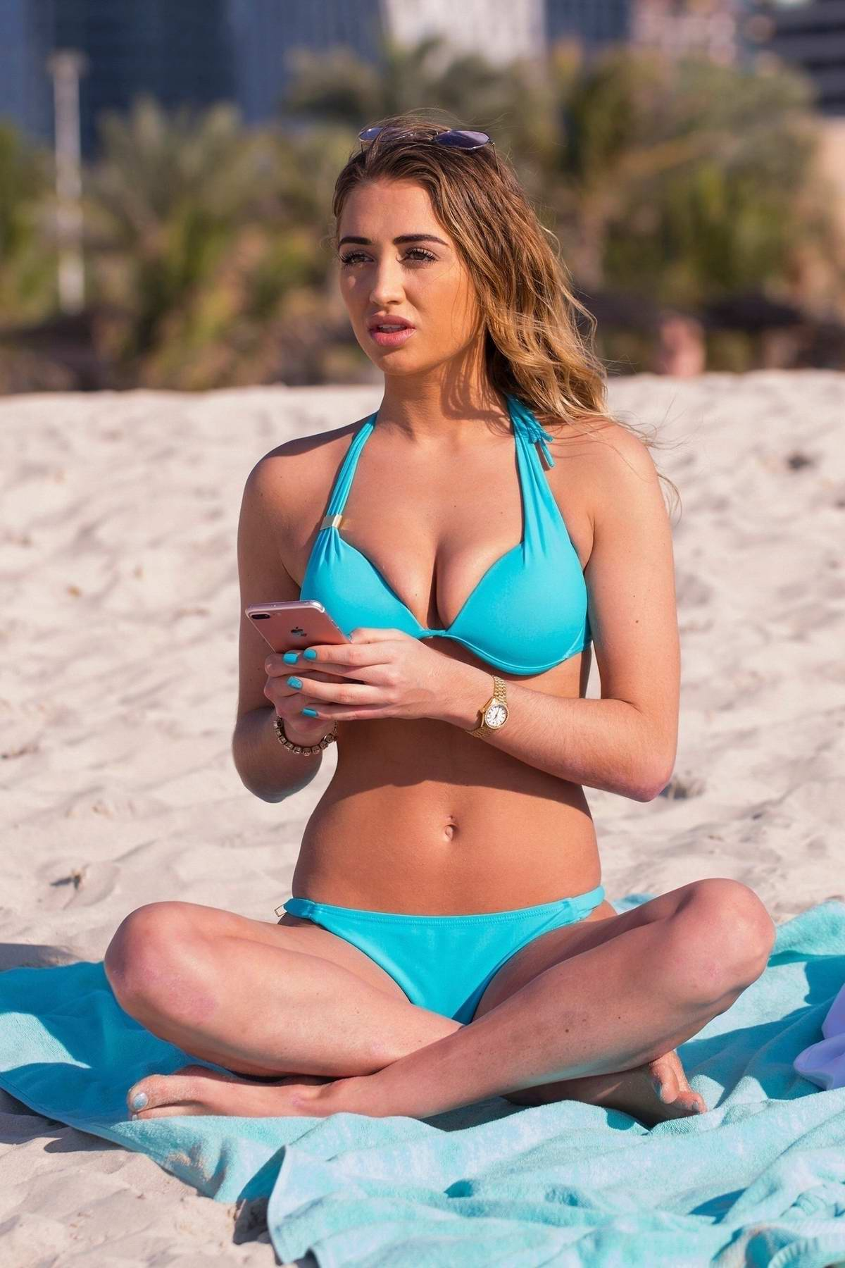 Georgia Harrison enjoys the beach in a blue bikini while on holiday in Dubai