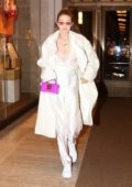 Gigi Hadid adds a pop of color to her all white ensemble during a dinner outing in New York City