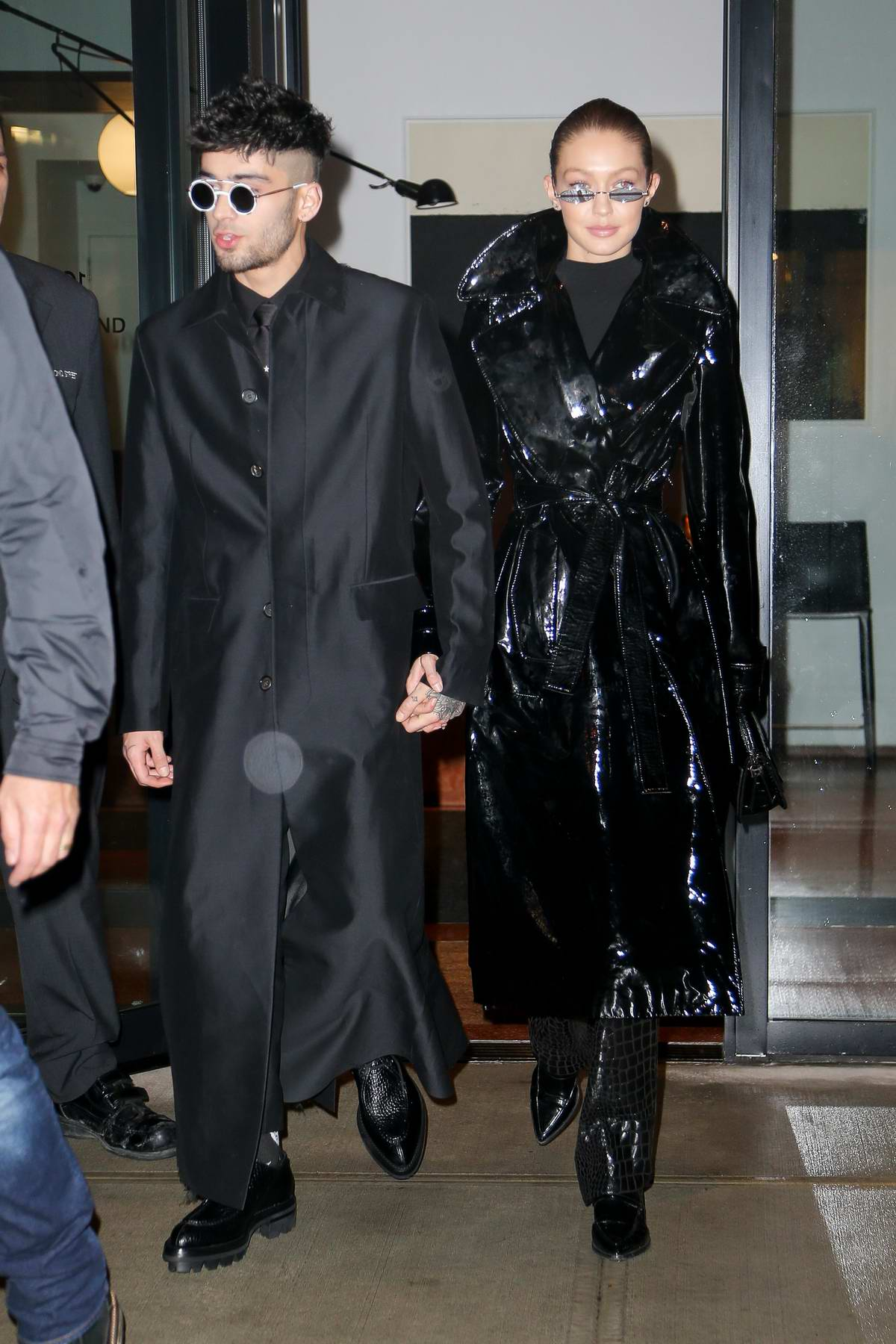Gigi Hadid and Zayn Malik seen wearing matching all black as they heading out to celebrate the singer's 25th birthday in New York City