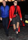 Gigi Hadid arrives at her apartment wearing a bright red parka in New York City