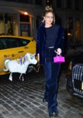 Gigi Hadid rocks a blue fur coat as she walks her balloon unicorn on the streets of New York City