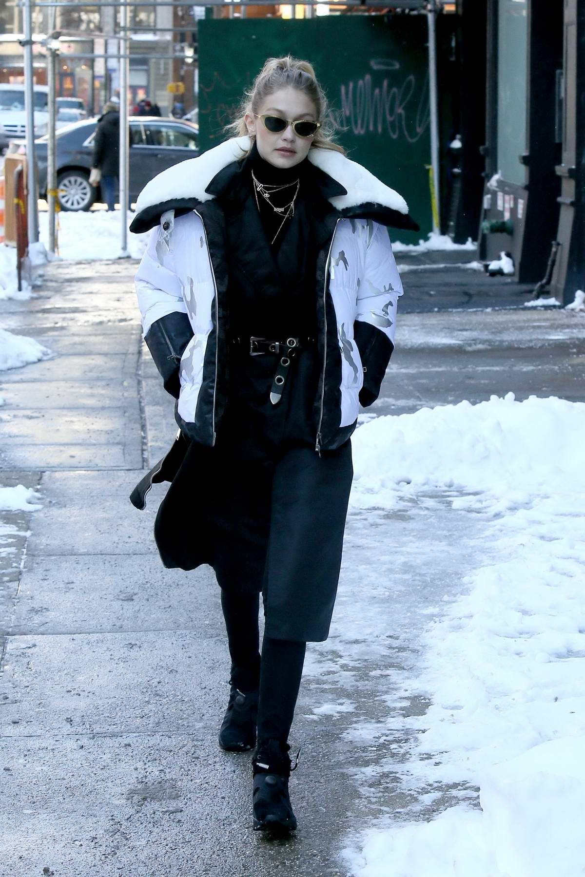 Gigi Hadid sports a black and white look as she heads out for lunch with a friend in Soho, New York City