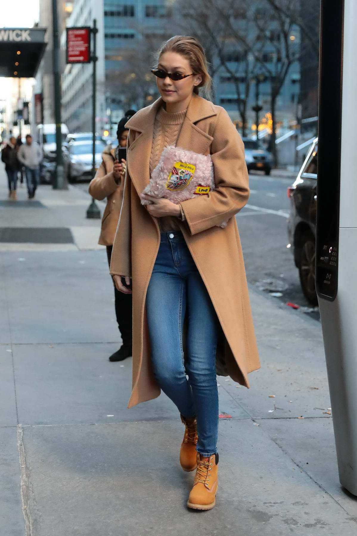 Gigi Hadid steps out in a beige trench coat and jeans as she runs errands in New York City