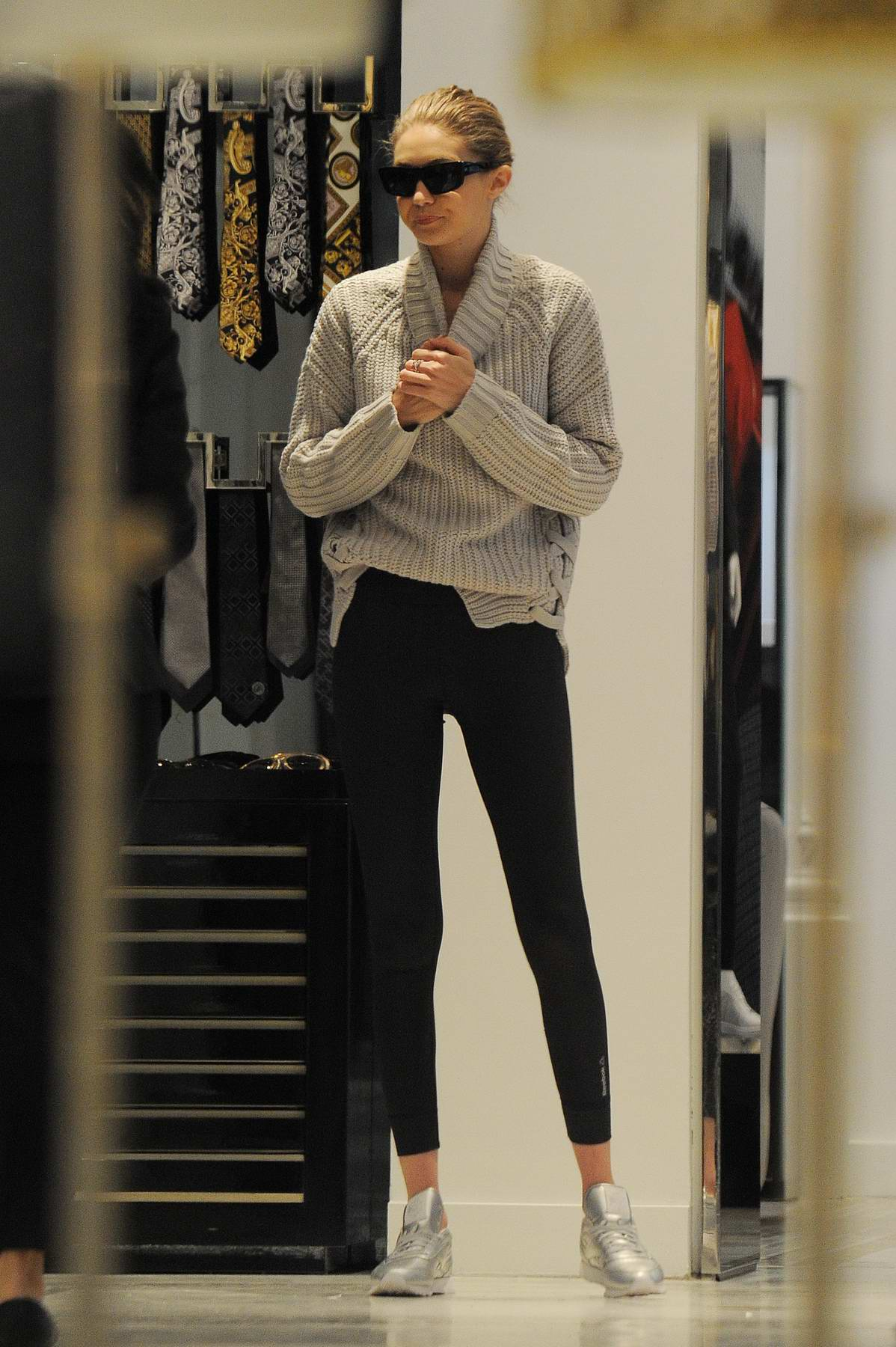 Gigi Hadid wears a grey turtleneck sweater and black leggings while shopping in Manhattan, New York City