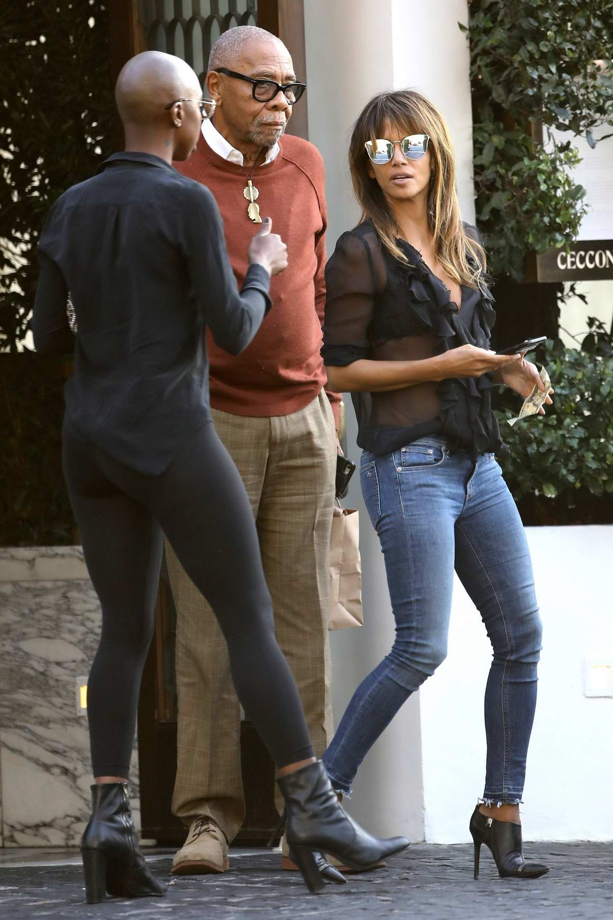 Halle Berry chats with her friends at valet after having lunch at Cecconi's in West Hollywood, Los Angeles