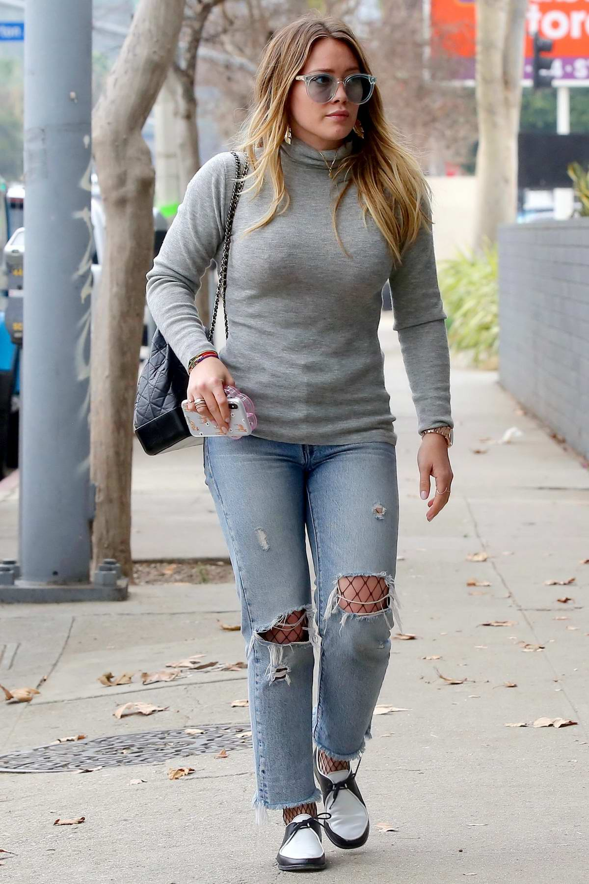 Hilary Duff wore ripped jeans and turtleneck while running errands in Los Angeles
