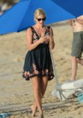 Holly Willoughby wears a black sundress at the beach during her family vacation in Barbados