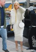 Iggy Azalea heads out in a cropped cream fur jacket and a tight fitting dress in New York City