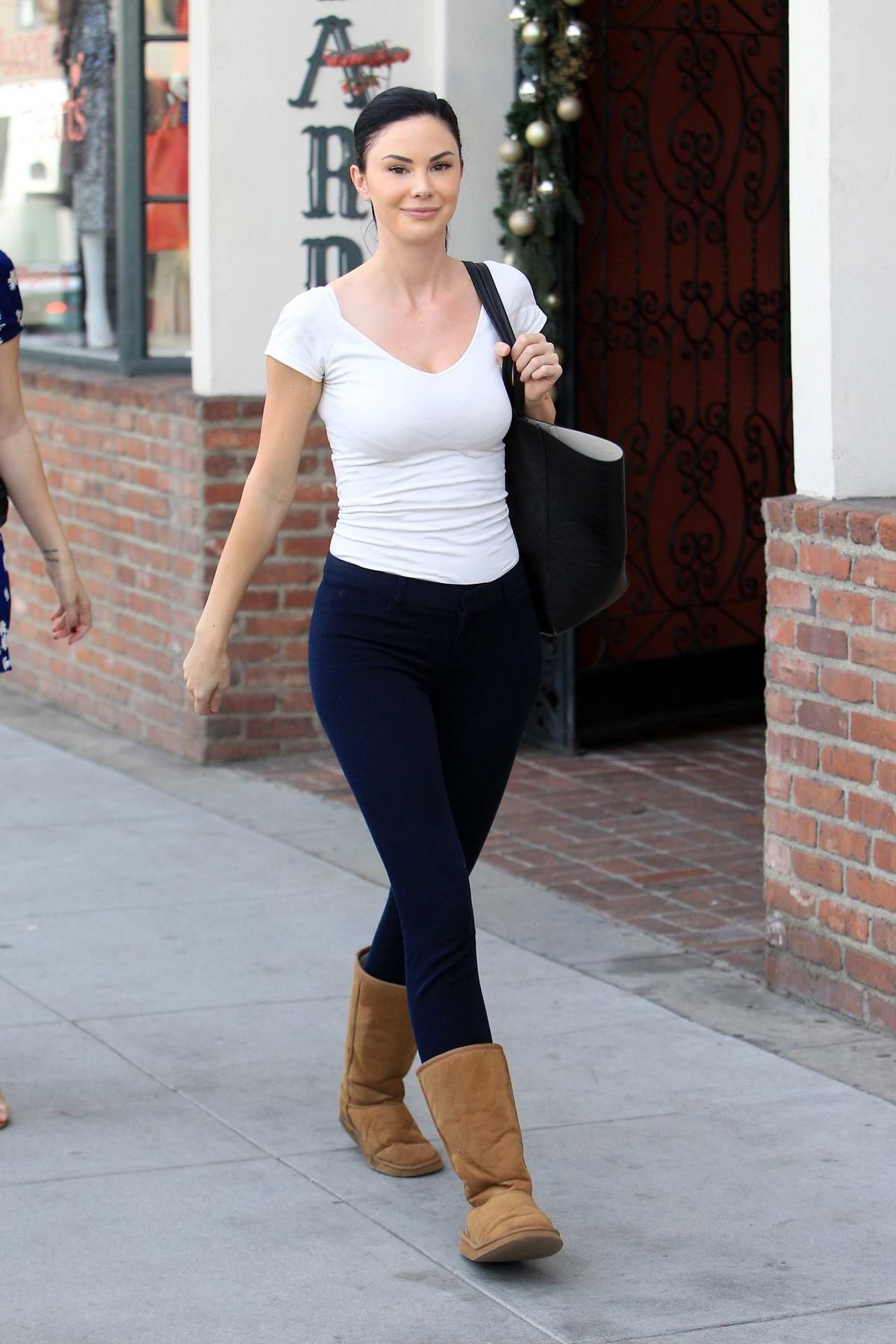 Jayde Nicole steps out in a white top, leggings and UGG boots as she grabs lunch with friends in Beverly Hills, Los Angeles