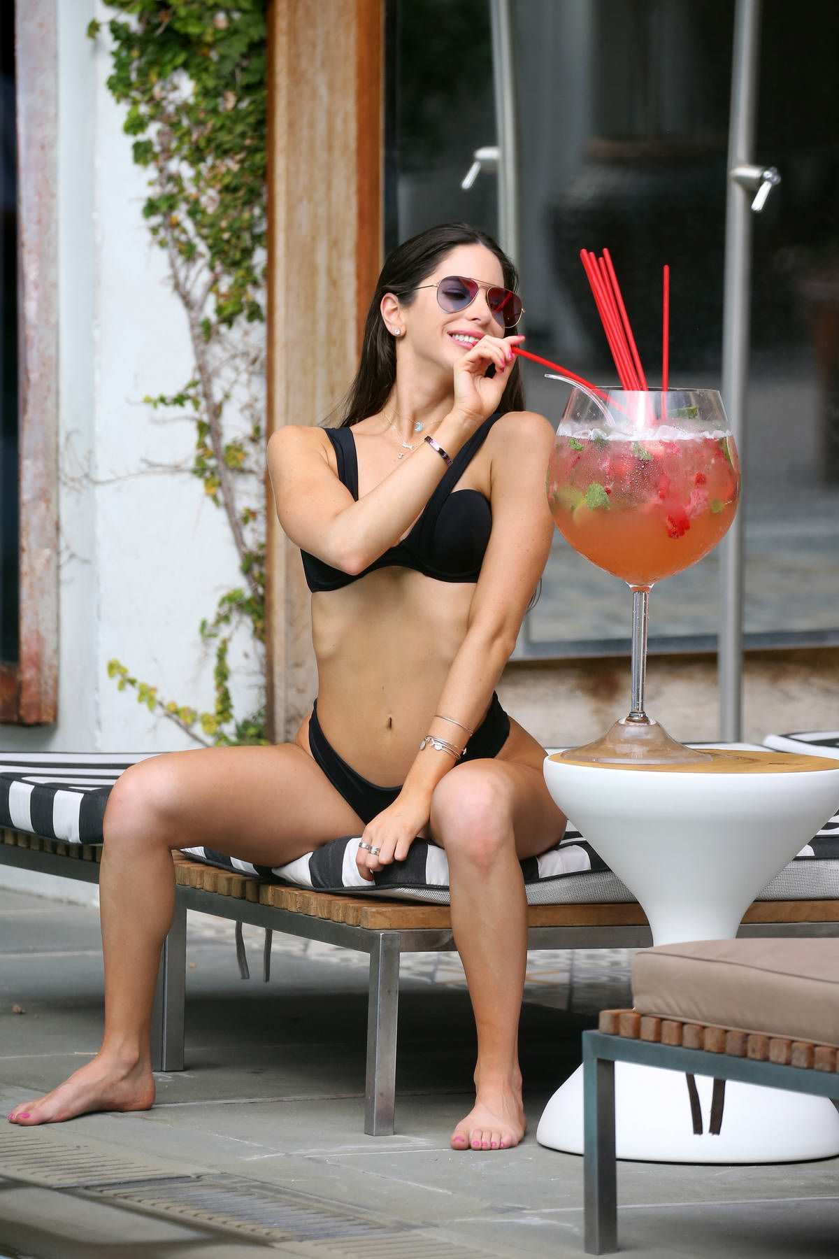 Jen Selter wears a black bikini and drinks a giant Mojito by the pool in South Beach, Miami, Florida