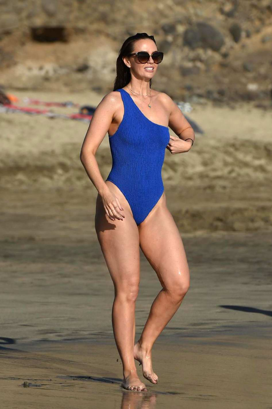 Jennifer Metcalfe hits the beach in a blue swimsuit in Tenerife, Spain