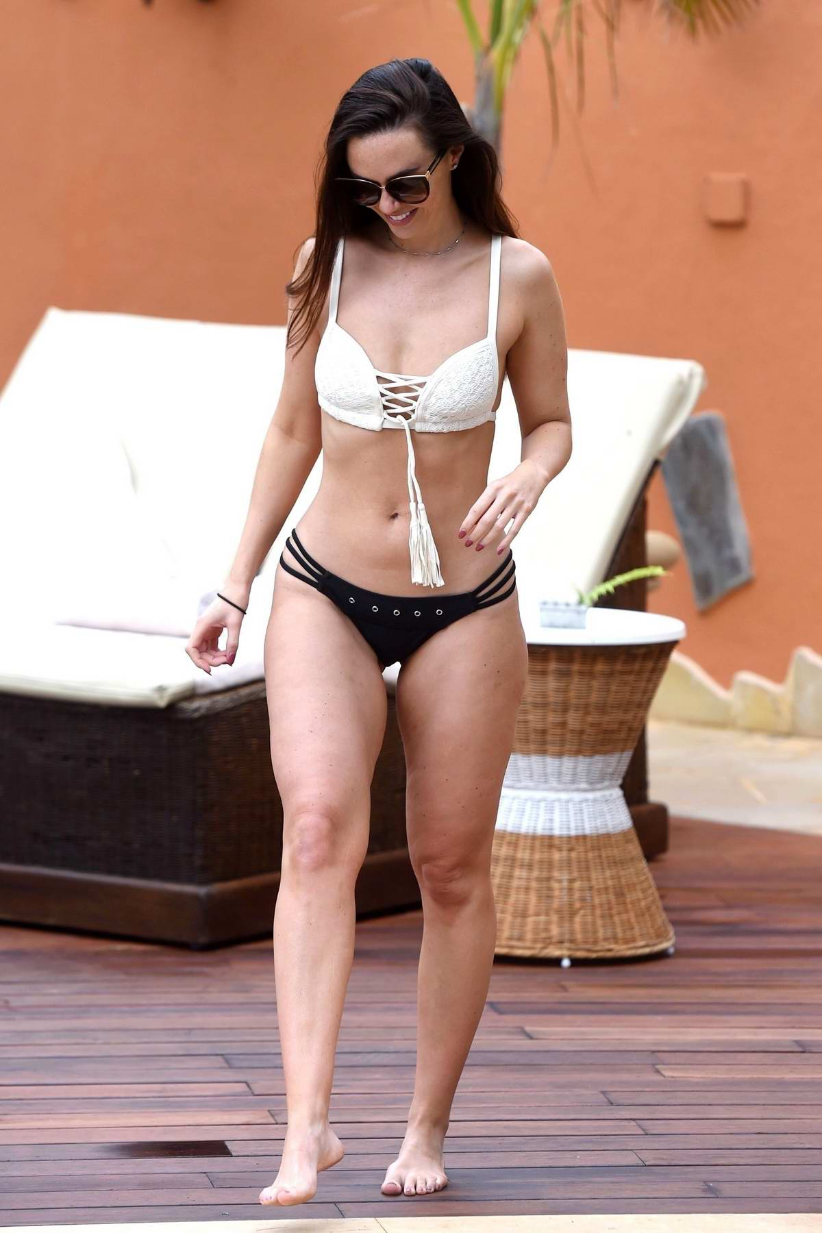 Jennifer Metcalfe unwinds by the poolside in a bikini as she enjoy her holiday in Tenerife, Spain