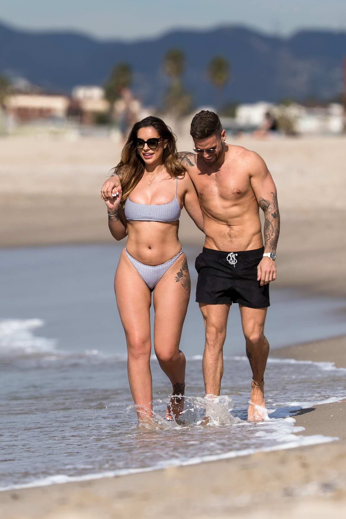 Jessica Shears dons a bikini while she enjoys some PDA with fiance Dom Lever at the beach in Santa Monica, California