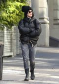 Julianne Moore keeps warm in a black puffer jacket and jeans while shopping at a clothing stores in NoHo, New York City