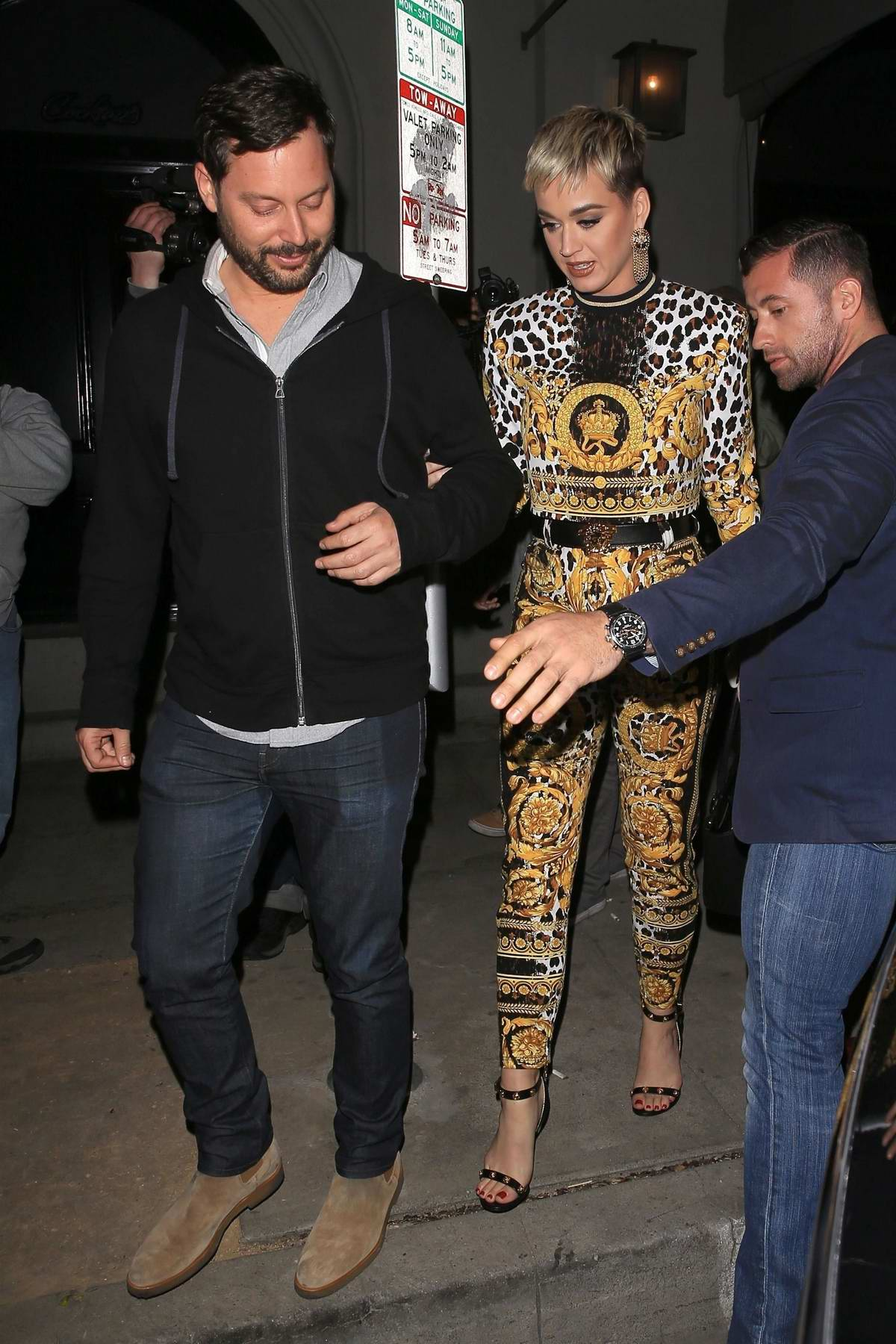 Katy Perry spotted as she leaves Craig's wearing bright yellow patterned outfit in West Hollywood, Los Angeles