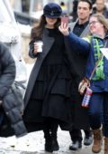 Keira Knightley wears a long grey coat with black dress while out for a stroll at the Sundance Film Festival in Park City, Utah