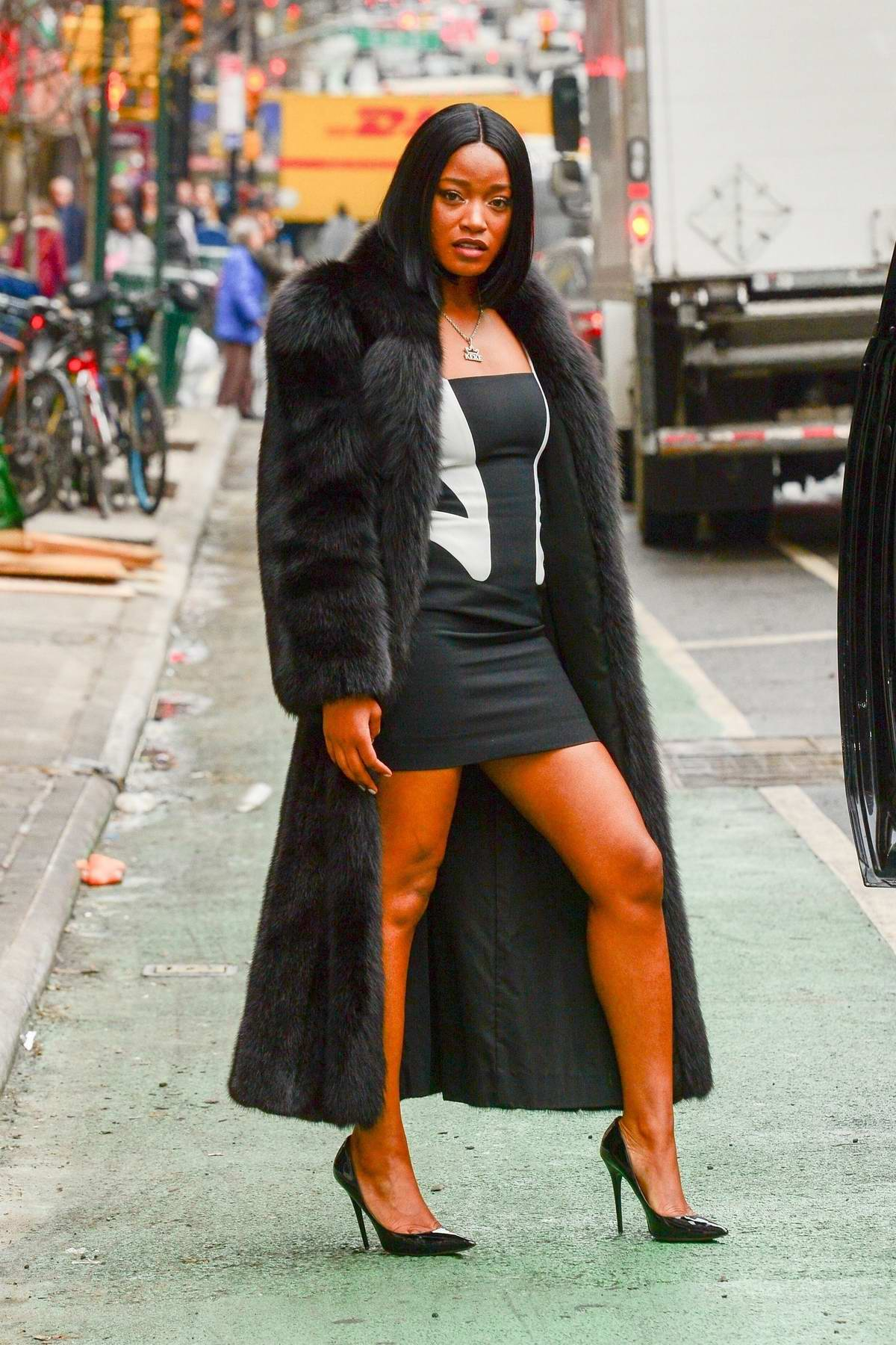 Keke Palmer wore a black and white short dress with a fur coat as she leaves ABC's TV show 'The View' in New York City