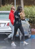 Kendall Jenner and Hailey Baldwin battles heavy rain while visiting a lawyer's office in Santa Monica, California