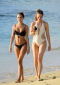 Kimberley Garner wearing a black polka dot bikini while she enjoys her vacation with friends at Niki beach in Barbados