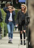 Kristen Stewart wears a pinstripe jacket and jeans while out with Stella Maxwell in Los Angeles