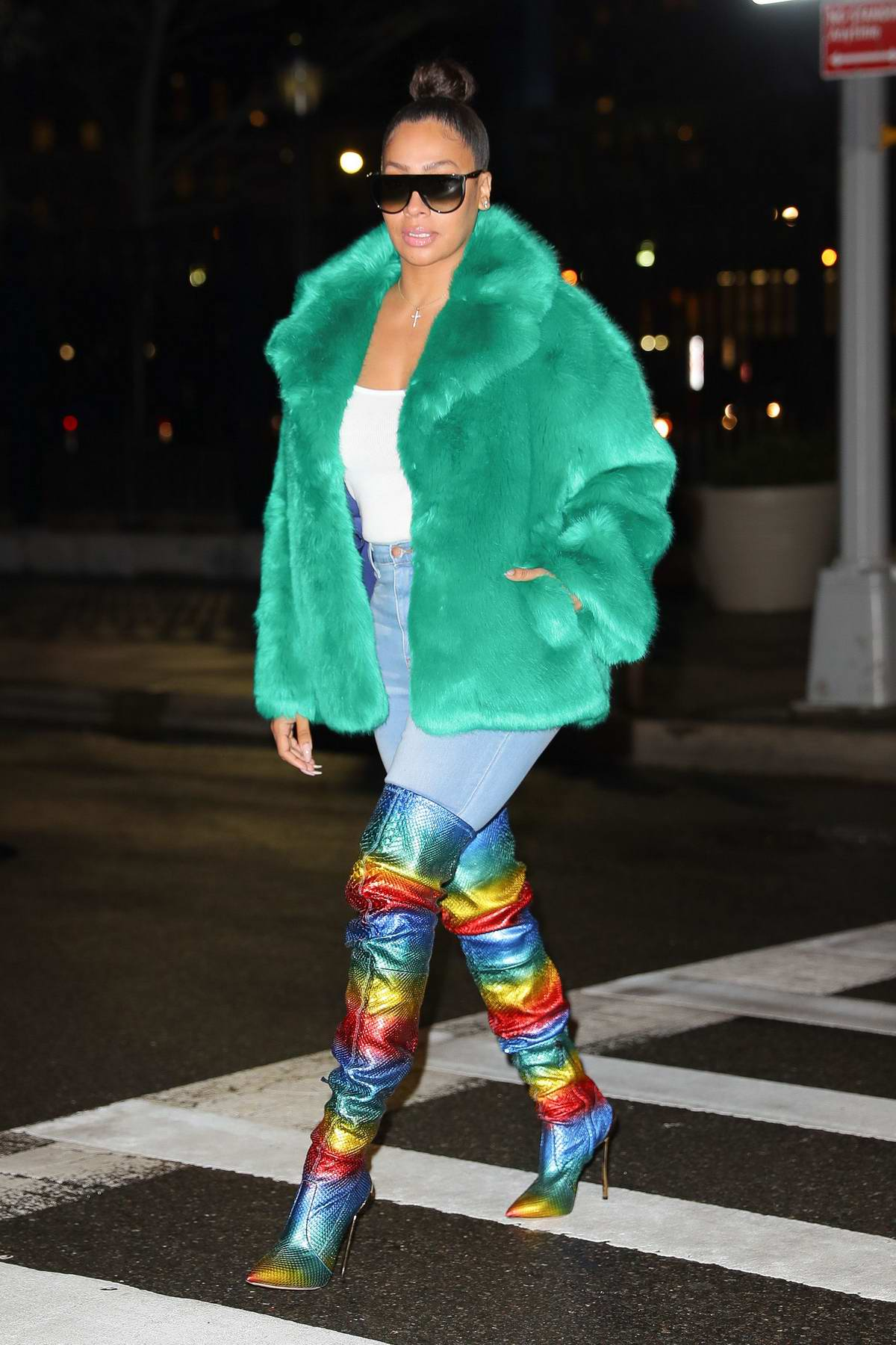 La La Anthony wore a faux fur collared jacket with a rainbow high knee boots while out in New York City