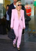 Lady Gaga dressed in a pink pantsuit arrives at Barcelona-El Prat Airport in Barcelona, Spain