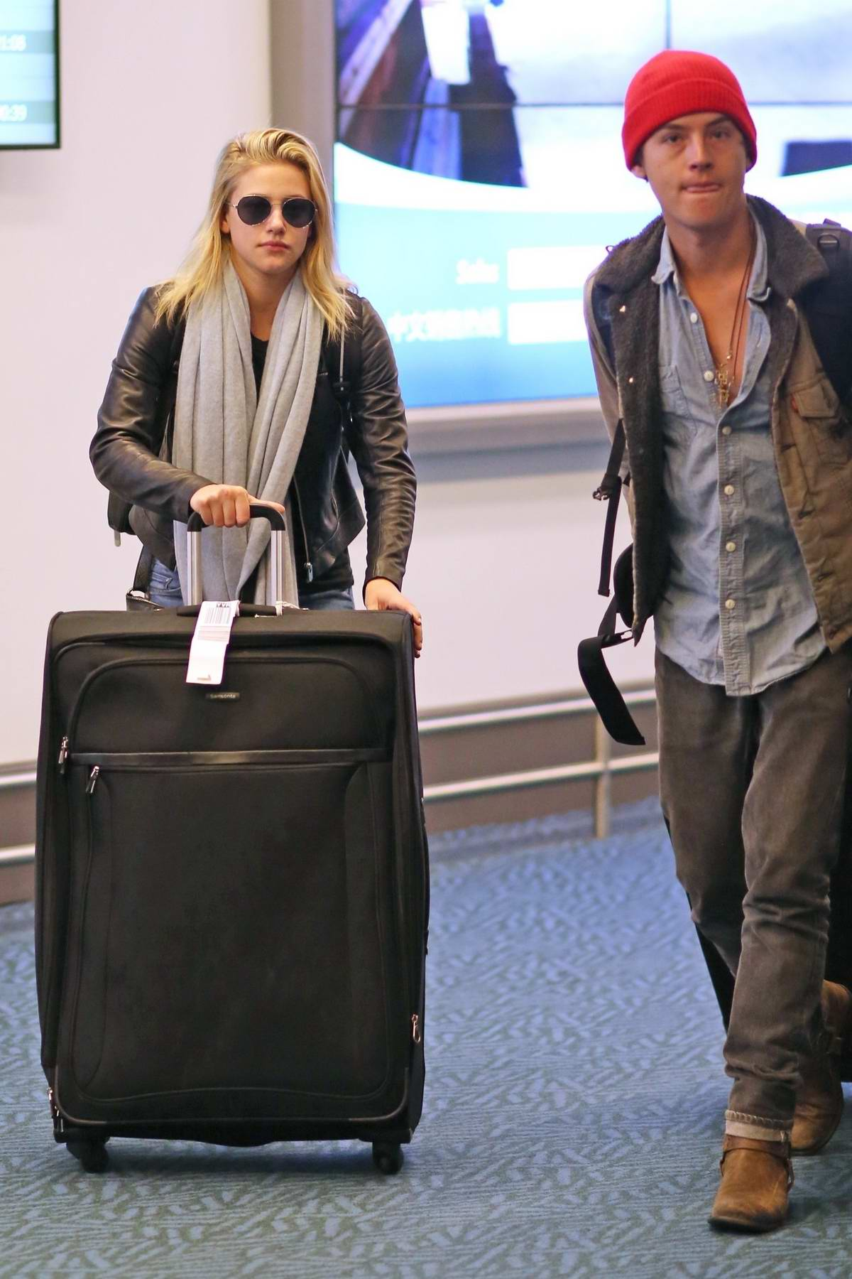 Lili Reinhart and Cole Sprouse were spotted arriving back in Vancouver, Canada