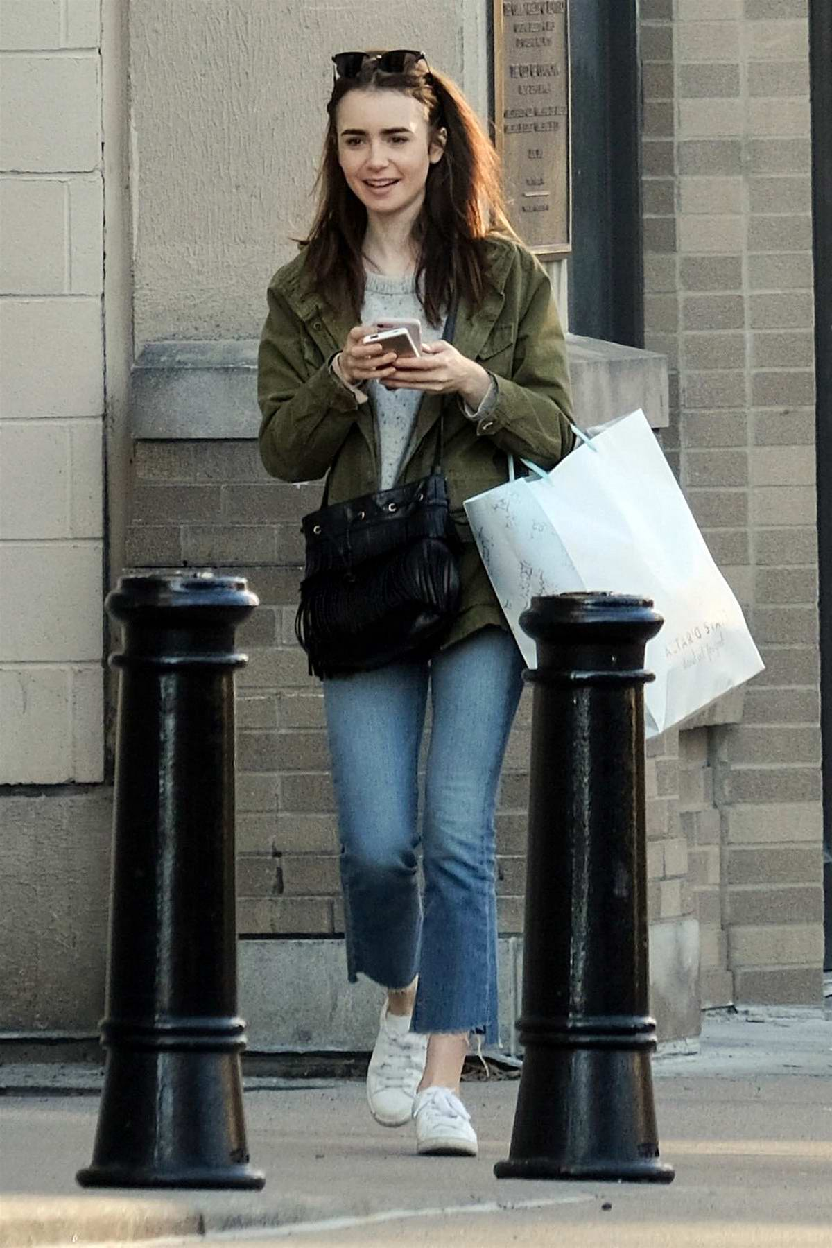 Lily Collins is spotted out shopping on her day off from filming in Cincinnati, Ohio