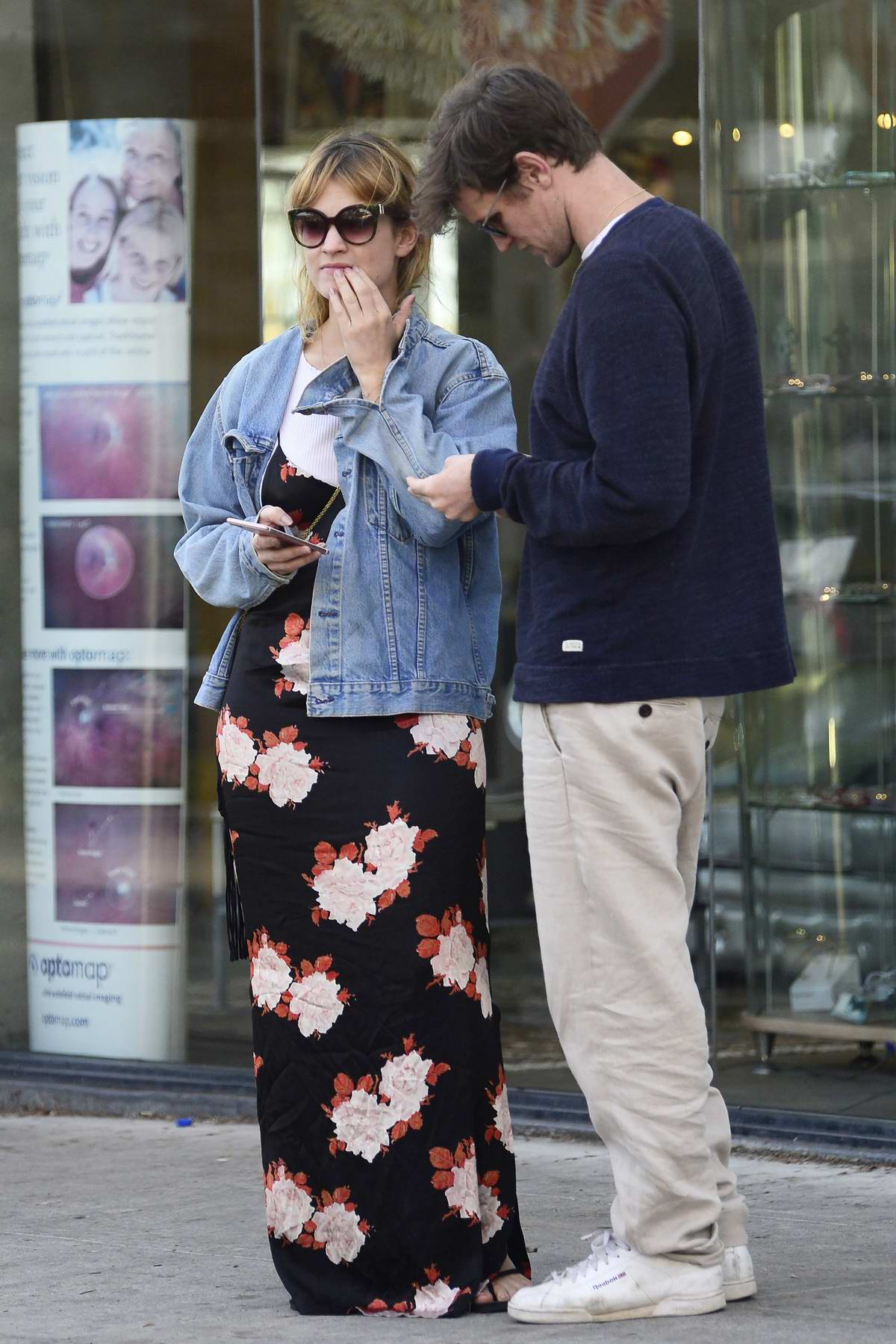 Lily James wore a maxi dress and denim jacket while out with beau Matt Smith as they enjoy a walk in Los Angeles
