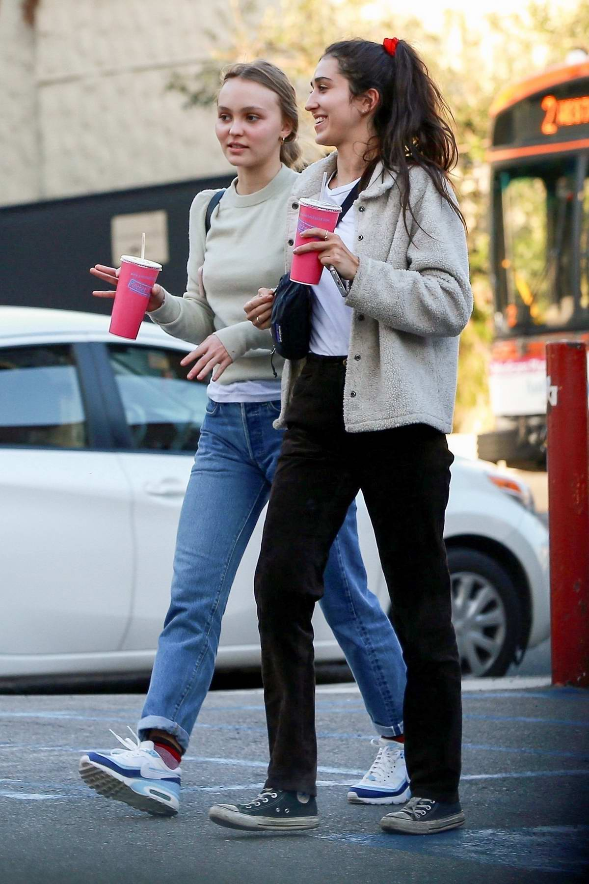 Lily-Rose Depp and a friend have lunch at Pinches Tacos in West Hollywood, Los Angeles