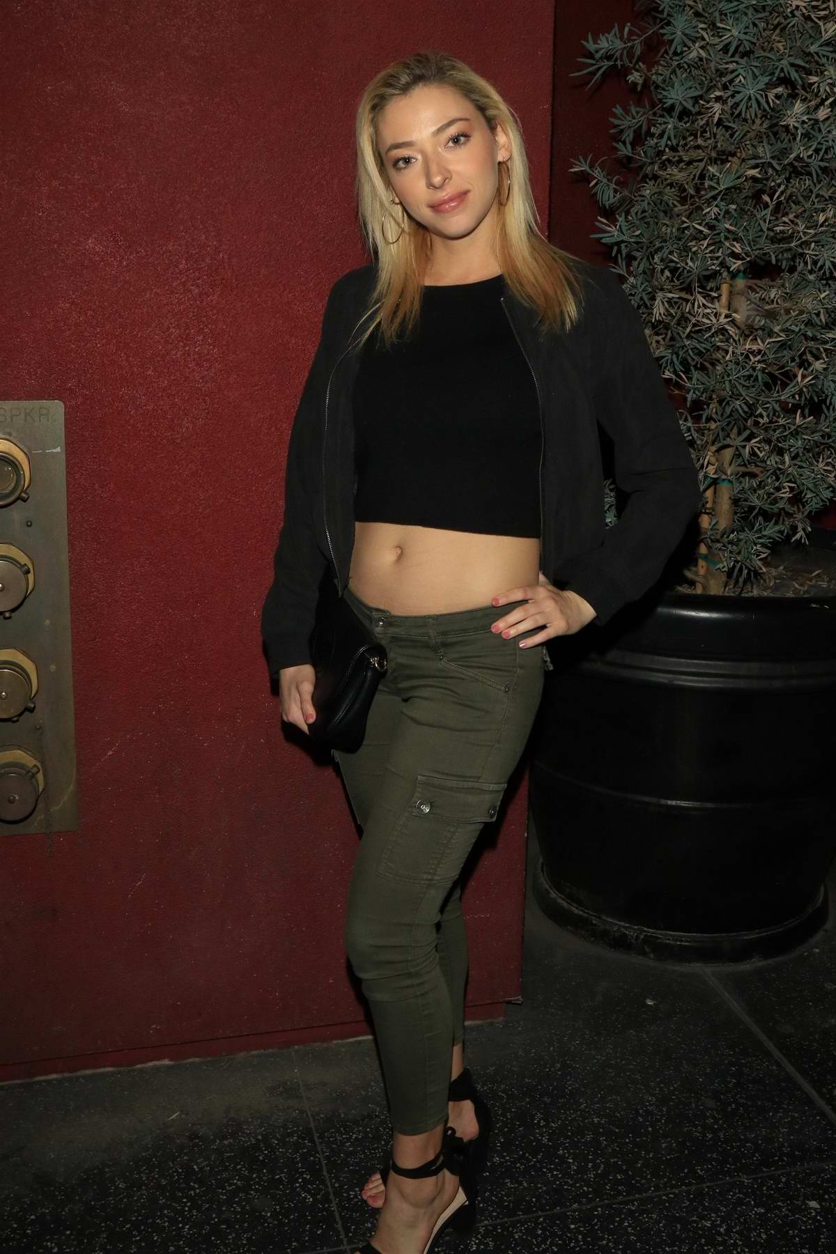 Liz Nolan poses for the cameras outside the Bardot nightclub in Hollywood, Los Angeles