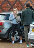 Louisa Johnson spotted carrying her pup as she arrives home in Essex, UK