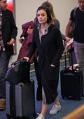 Lucy Hale spotted at the airport as she arrives back to resume filming of 'Life Sentence' in Vancouver, Canada