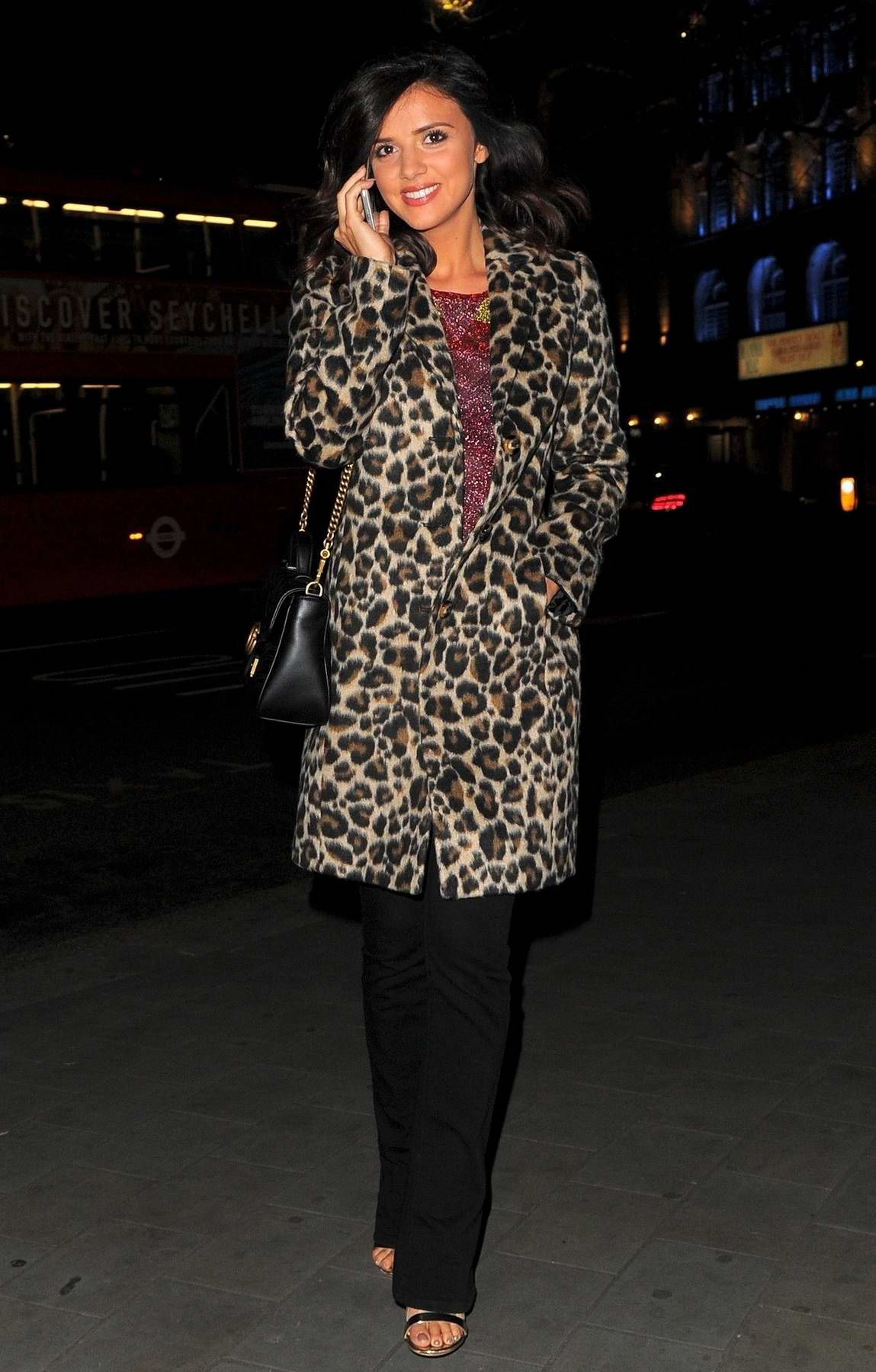 Lucy Mecklenburgh wears a leopard print coat while out and about in London