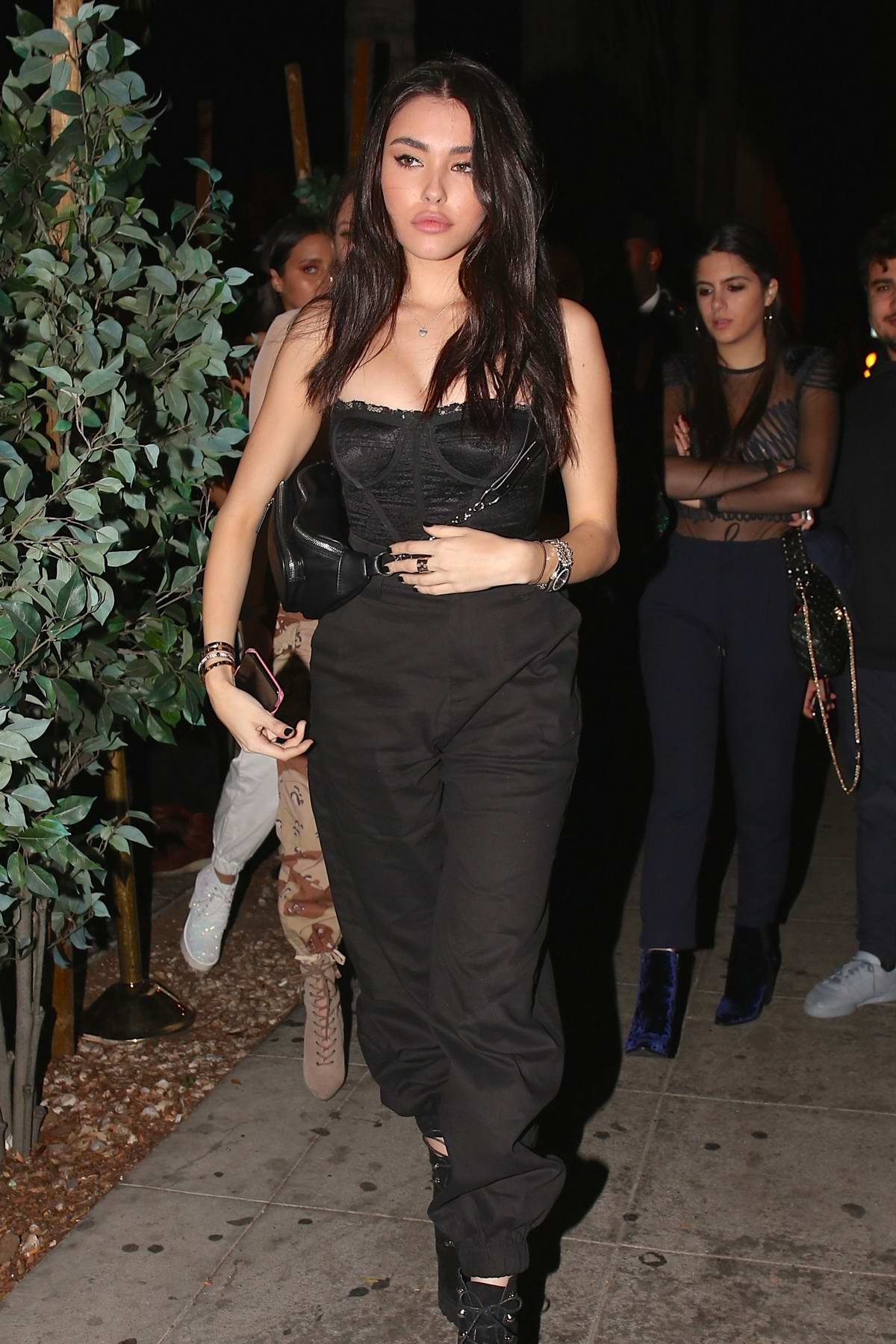 Madison Beer wears all black while on a night out with friends at Delilah in West Hollywood, Los Angeles