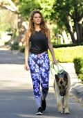 Maria Menounos wears a blue floral print leggings and black vest top as she walks her dog in Los Angeles