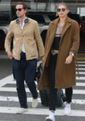 Maria Sharapova spotted in a brown coat as she lands at LAX airport with a friend in Los Angeles