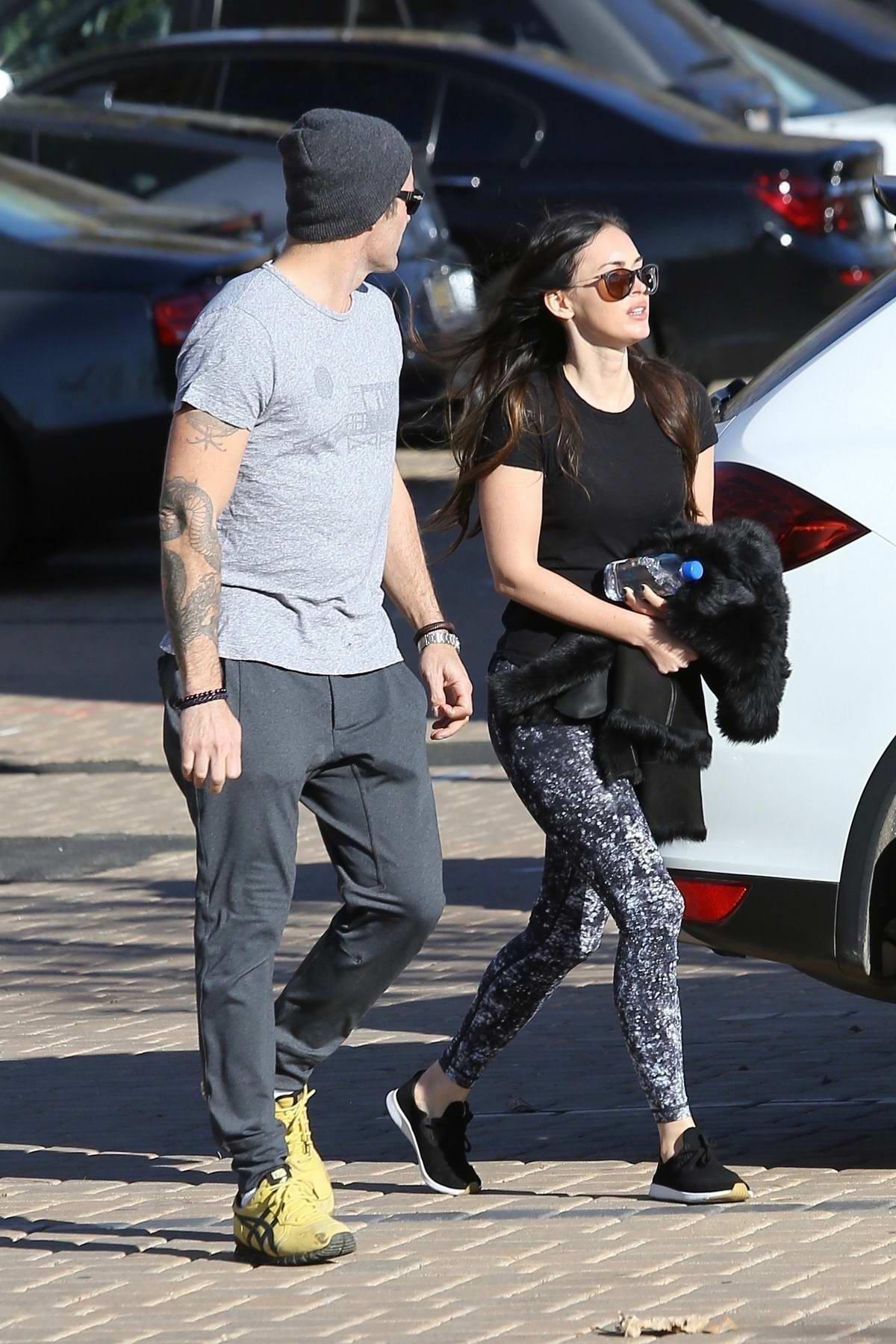 Megan Fox and Brian Austin Green walk back to their car after shopping at Malibu Country Mart, Malibu, California