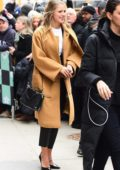 Melissa Benoist visits AOL Build Studios wearing a brown long coat and black leather pants in New York City