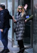 Michelle Hunziker waves to the cameras as she head out on her 41st birthday in Milan, Italy