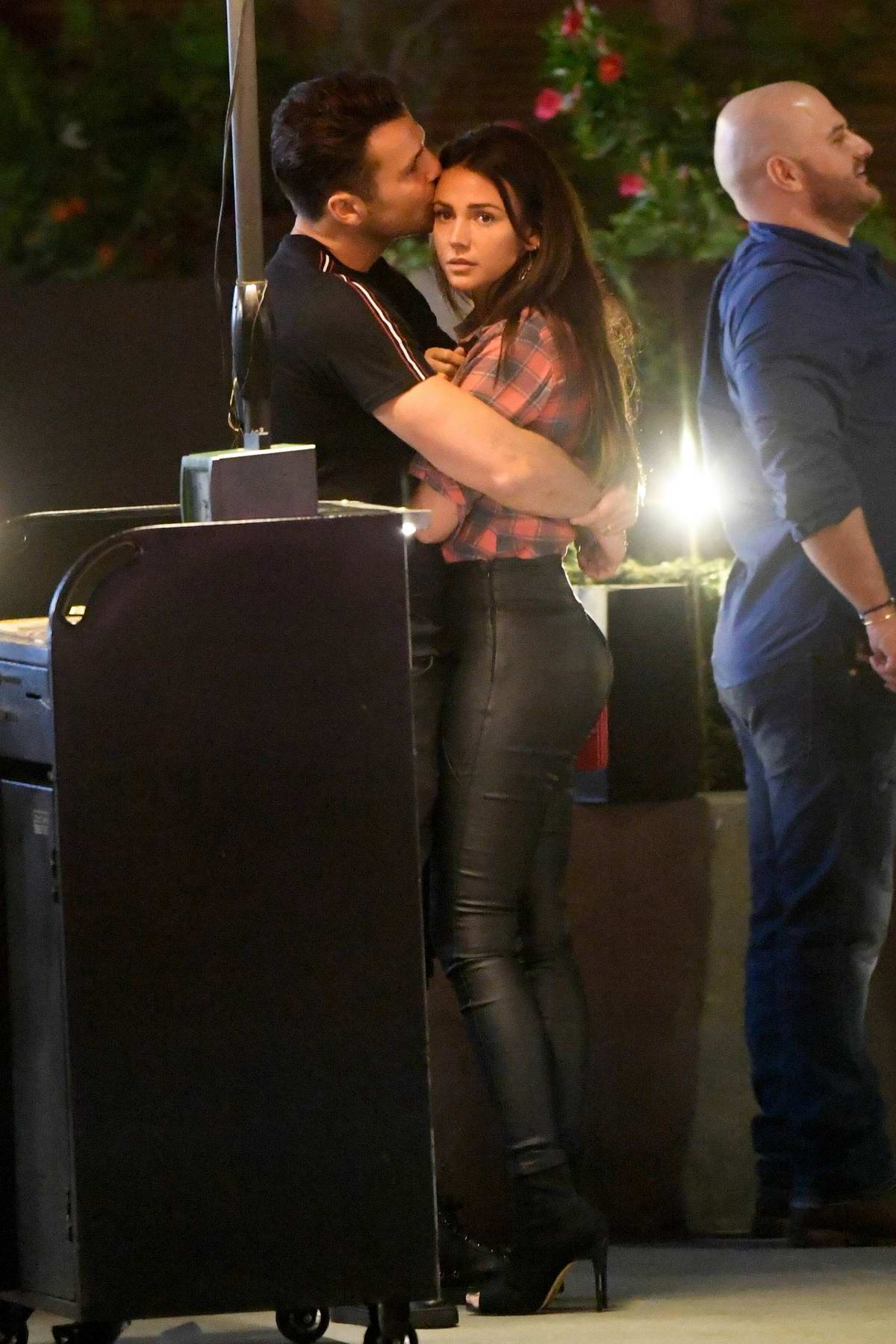 Michelle Keegan and Mark Wright share a kiss while waiting at the valet after dinner in Brentwood, Los Angeles
