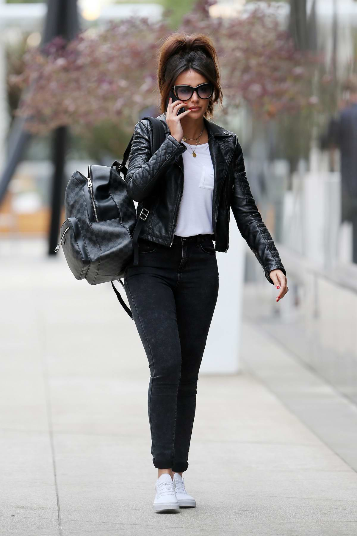 Michelle Keegan leaving the gym after her morning workout wearing black leather jacket and jeans in Los Angeles