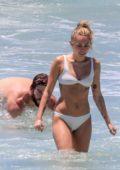 Miley Cyrus hits the ocean in a white bikini with Liam Hemsworth in Australia