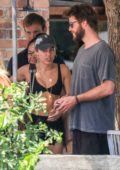 Miley Cyrus wears a sports bra and denim shorts while out for lunch with Liam Hemsworth in Byron Bay, Australia