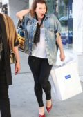 Milla Jovovich have fun with Paparazzi while out for some shopping in Beverly Hills, Los Angeles