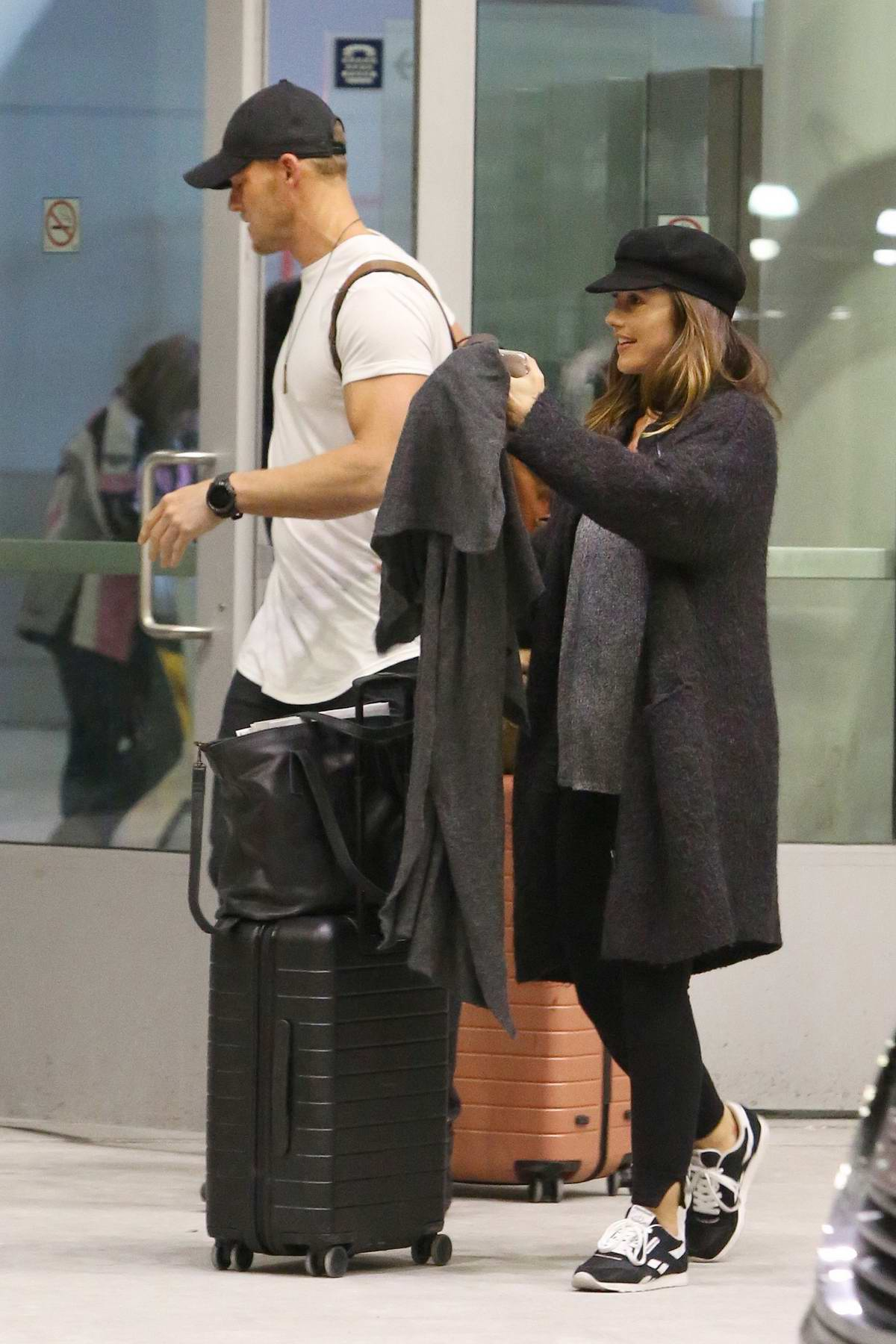 Minka Kelly and Alan Ritchson arrives to an airport in Toronto, Canada